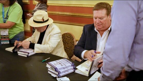 Ken and Michael Signing Books